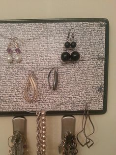 My take on the jewelry wall hanger...wood block, mod podged with scrapbooking paper, drilled in some hooks, and added picture hanging wire!!! Then I just stuck some big 3m hooks underneath to hold my necklaces!! Viola!!