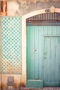 Tiffany blue door #33 of the Azulejo house in Lisbon, Portugal. #turquoise #aqua
