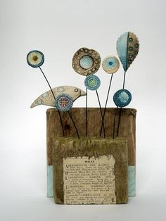 Shirley Vauvelle, Mixed Media Artist : Little Bird (of Wales) / ceramic driftwood vintage newspaper cutting, 10cm x 15cm x 6cm