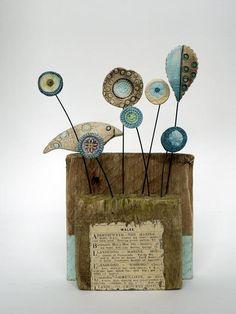 Shirley Vauvelle, Mixed Media Artist : Little Bird (of Wales) / ceramic driftwood vintage newspaper cutting, 10cm x 15cm x 6cm