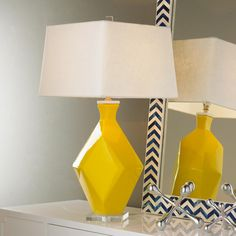 """Parallelogram Transformations Table Lamp Prism, diamond and parallelogram surfaces make a shining show in sunny yellow! White linen cube shade and clear acrylic square base add even more geometric appeal. 3-way 100 watts. (27""""Hx14""""W) Base: 5"""" square 9' clear cord. Shade: 12""""x14""""x10"""""""