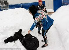 Oops! Rodrigo dropped his statement fur coat in the snow during his fun day out...