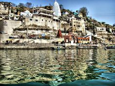 #Omkareshwar, 77 km from Indore, is a Hindu temple dedicated to God Shiva. It is one of the 12 revered Jyotirlinga shrines of Shiva.