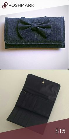 NWT Distressed Denim Wallet with Bow Brand New wallet perfect for all of your cards and cash, with a compact fit.  Dimensions are as listed Approx 6.5 inches long Approx 3.5 inches tall Bags Wallets