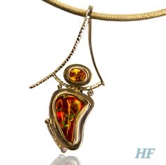 AUTUMN SUN Slide - Fire Agate, 10.14cts, with Spessertite Garnet, 1.44cts, set in 18k and 14k yellow Gold, two accent Diamonds, .04cts.