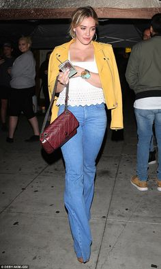 Feeling bright: Hilary Duff, 28, headed out with her pals to the celebrity hot-spot The Ni...