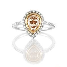 An White and Rose Gold Fancy Coloured Diamond Halo Ring with a Pinkish Brown Pear Shaped Diamond in the Center Pear Shaped Diamond, Halo Diamond, Diamond Rings, Diamond Engagement Rings, Halo Rings, Vintage Rings, Colored Diamonds, Jewelry Collection, Rose Gold