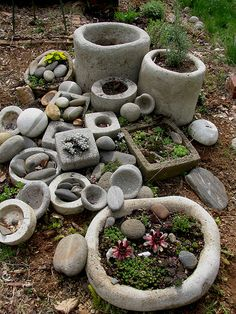 this is my spring project, arranging these planters and rocks and putting in plants