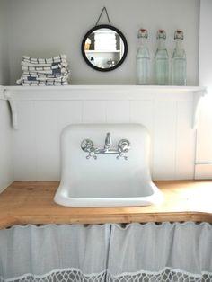 wainscoting and shelf. vintage sink and skirting