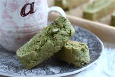 Green Tea Biscotti - 1 3/4 cup all-purpose flour  1/2 cup granulated sugar  1/2 teaspoon baking powder  1 1/4 tablespoon matcha powder  1/8 teaspoon Kosher salt  2 large eggs  2 tablespoons unsalted butter, melted and cooled  1/2 teaspoon vanilla extract  1/4 cup slivered almonds  1 egg white  1 tablespoon turbinado sugar
