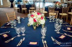 Our reception tables were perfect in navy, gold, and raspberry! Wedding at River House Events in St. Augustine, by www.oncelikeaspark.com!