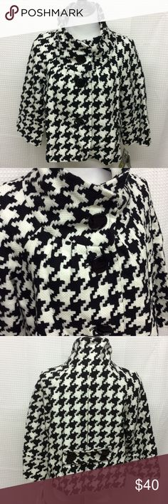 """NYGARD Blk/Wht Herringbone Crop Jacket NWT Size 14 NYGARD'S cropped """" Babydoll """" Jacket is done in a textured, Black and White large herringbone pattern.  NWT!! 100% acrylic, dry clean only. Details include a great stand up funnel neckline, front slash pockets, 3/4 sleeve, belted back with button accents, and three 1 1/2"""" front, black buttons. ( extra button is included ). Fully lined in black. Shoulder 20"""" across, length 20"""", 3/4 sleeve is 13"""" long, width 22"""" down to 24"""" across. This is…"""