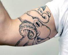 Octopus tattoo around the arm. I don't know why, but I really want one.