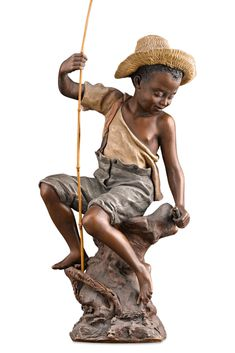A young fisherman smiles down at his catch in this charming polychrome  terracotta figure by the famed Friedrich Goldscheider of Vienna. This  endearing piece is quintessential Goldscheider, epitomizing both the  aesthetic appeal and naturalistic design of the Art Nouveau period. ~ 19th Century Sculpture, Antique Terracotta sculpture ~ M.S. Rau Antiques