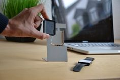 simple and minimalistic charging-dock for various types of smartwatches you can fold yourself!