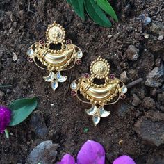 Product Details: Base Material - 92.5 Carat Pure Silver with Gold Plating Technique - Handcrafted Product Type -Temple Jewellery Design - Drops Stones Colour -Red And White  Length - 2 inch Width - 1.5 Care Instructions - Avoid Contact with Perfumes and Water  Contact No - +91 8095752326  E-Mail - contactus@madhurya.com   Also available in Pure Gold* Shipping Worldwide