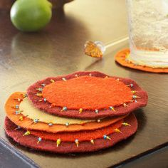 Harvest-Colored Felt Coasters    Coasters made from different-size circles of felt add a splash of autumn to any room. Freehand-cut shapes or use a die-cutting tool. Use simple stitches to tack the pieces together, and add beads to the embroidery floss for decoration.