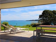 Picnic Bay Holiday Home on Waiheke Island offers large luxury living and direct beach access. Make yourself at home on Waiheke Island. Be My Guest offers. Waiheke Island, Outdoor Chairs, Outdoor Decor, Open Fires, Waterfront Homes, Auckland, Sun Lounger, Lawn, Golf Courses
