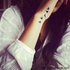 Best Tiny Tattoo Idea - Birds Leaving Her Wrist Tattoo Idea - Top Tattoo Ideas