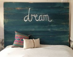 Teal Distressed Headboard by RoomForSeconds on Etsy, $295.00; Made of repurposed fence boards, painted with variations of dark and light teal color and distressed to add dimension and depth to the board. Sanded and buffed for a VERY smooth touch.  Wall mounted only. Mounting hardware is included.
