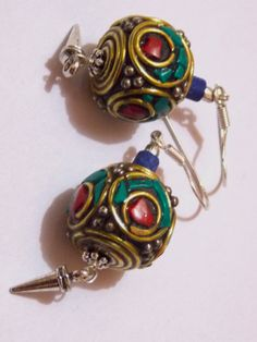 Brass earrings with stones. With silver wire and antique steel beads. In India, there is a state called Rajasthan. Women wear this type of jewelry on many occasion, like - Gangour, Teej, etc.