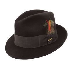 "This Stetson Fedora is made of Premium Wool Felt, has a 2 inch Brim with a Grosgrain Ribbon Band and Embellished with Stylish Feather and Gold Stetson Emblem. Famous Words of Inspiration.""A woman seldom asks advice before she has bought her wedding. Western Hats, Cowboy Hats, 1920s Mens Hats, Stetson Fedora, Fedora Hat Women, Stylish Hats, Dress Hats, Hats For Men, Women Hats"