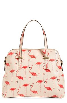 This adorable flamingo satchel adds a cute tropical feel to an everyday look.