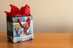 Newspaper gift bag. I used to wrap my gifts with the funny paper all the time. Love this idea!