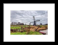 Beautiful landscape with a spiderhead windmill in the Netherlands by Tim Abeln Photography and Digital Art. Beautiful art prints and wall decoration for your home and office. Landscape image of a Spiderhead mill in Laag-Keppel, the Netherlands. If you look closely you can see the miller busy turning the mill.