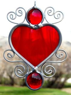 beautiful stained glass heart sun catcher. so in love with this Someday I would love to try doing this