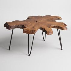 Our coffee table is crafted in Indonesia from a real slice of richly-grained teak root with inherent holes, knots and variations in size and shape. Featuring black mid-century style hairpin legs, this standout $179.99 piece is truly one of a kind.