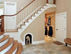 Here's another idea for using the space under your staircase. What do you think?