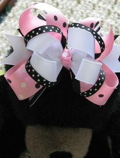 pink and white with black hairbow
