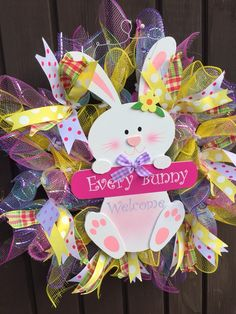 Deco mesh wreaths with ribbons and bows for training Easter bunny hanging in the middle Easter Wreaths, Deco Mesh Wreaths, Spring Crafts, Easter Bunny, Bows, Christmas Ornaments, Holiday Decor, Ribbons, Middle