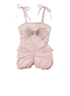 The marshmallow coloured tutu onesie features silk ribbon straps, tied in bows at the shoulders, and a silky edged neckline. The bodice is embellished with lines of silver and white sequins, exploding outwards from the centre in a bow shape. At the waist, ruched tulle forms a mini tutu and faux pockets are stitched on the puffball shorts. www.tutudumonde.com