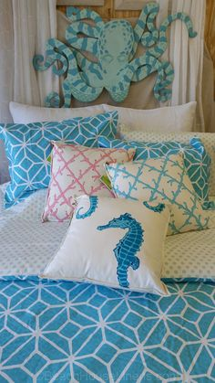 """True to her vivid style in color and pattern, Trina Turk creates a bold aqua bed infused with two geometric designs. The overall white and aqua repeating diamond is overlayed on a smaller textured design. Three piece comforter set includes the comforter and 2 shams. Queen set's comforter is 92x96"""" and two 21x27 standard shams."""