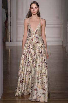 This Glamorous Fashion Editor Wore Leggings to a Couture Fashion Show via @WhoWhatWear