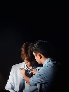 D.O fixing Kai's bow^.^