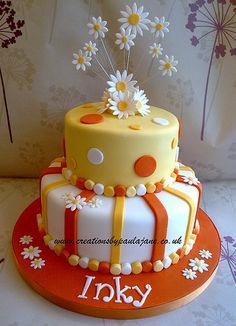 orange and yellow daisy cake
