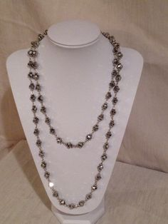 60 inch glass crystal necklace, silver.