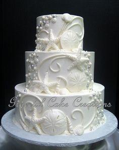 https://flic.kr/p/x4K7a7 | Elegant Beach Themed White Butter Cream Wedding Cake with Shells, Scrolls and Beads