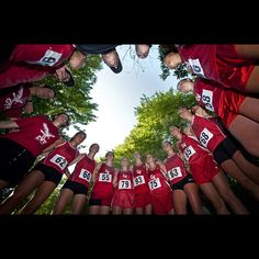 The CVU girls cross country team huddles at Red Rocks Park in South Burlington Wednesday. Photo by Glenn Russell