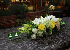 The set of unique flowers with a decorative table candles