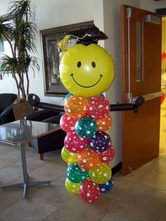 Graduation Balloon Decor. This graduation person made out of balloon is really stunning and eye catching. All you need is to put colorful balloons of various shapes together. http://hative.com/graduation-party-ideas/