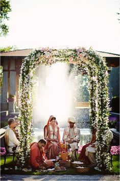 FAVE - cy, sonya, meghan Floral mandap design for Indian wedding ceremony.
