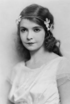 Lillian Gish, head-and-shoulders portrait, facing slightly left, possibly in  costume. Photo by Charles Albin, New York, 1922.