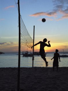 People Playing Volley Ball on White Beach at Sunset, Boracay, Philippines