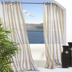 Add a breezy touch to your balcony or highlight your living room with this versatile curtain, showcasing a stripe motif for classic style.     ...