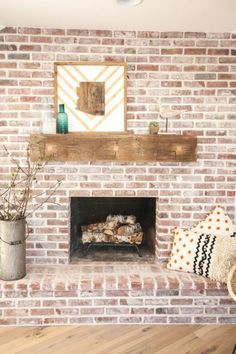 Eclectic Home Tour - Rafterhouse - Brick fireplace with antique beam mantel eclecticallyvinta… - Brick Fireplace Mantles, White Wash Brick Fireplace, Brick Fireplace Makeover, Fireplace Ideas, Stone Fireplaces, Fireplace Design, Farmhouse Fireplace, White Wash Brick Exterior, Brick Fireplace Remodel