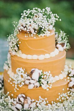 rustic wedding cake with cotton and baby's breath - gorgeous!!